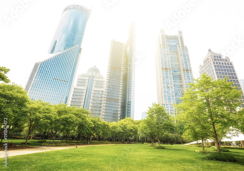 Modern architecture of Shanghai, China. Lujiazui Central Greenland with green trees and lawns. Travel background.