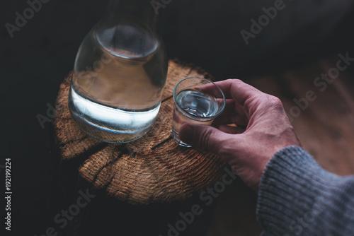 Man drinking strong alcohol drink Fototapeta