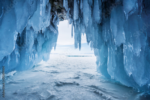 Fotografia, Obraz Winter Landscape, Frozen ice cave with bright sunlight from way out at lake Baik