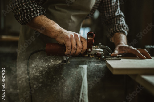 carpenter works with manual and electric equipment Fototapet