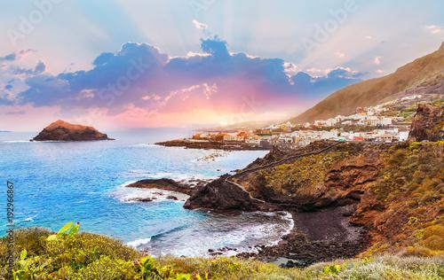 Beautiful sunset over Garachico village, seaside in summer holiday in Tenerife island, Spain