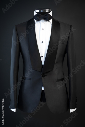 Wallpaper Mural Tailored suit, tuxedo isolated on black background on mannequin
