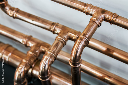 copper pipes and fittings for carrying out plumbing work. Fotobehang