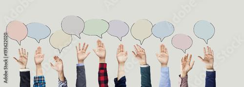 Fotografía Hands raised with speech bubble