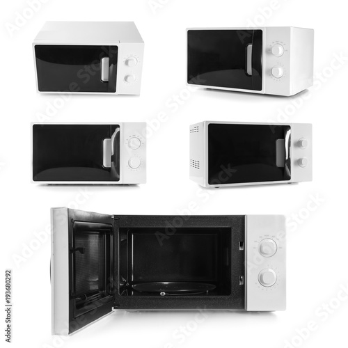 Set of microwave ovens on white background