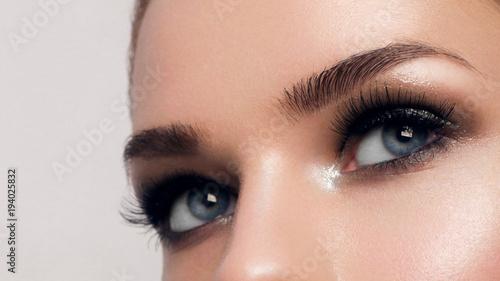 Slika na platnu Macro shot of woman's beautiful eye with extremely long eyelashes
