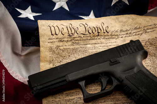 Canvas Print The second amendment and gun control in america concept with a handgun and the a