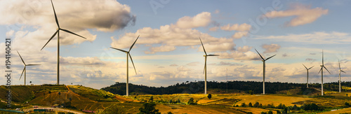 energy saving concept with panorama view from wind turbine construction in field and meadow on mountain with beauty blue sky and cloudy background