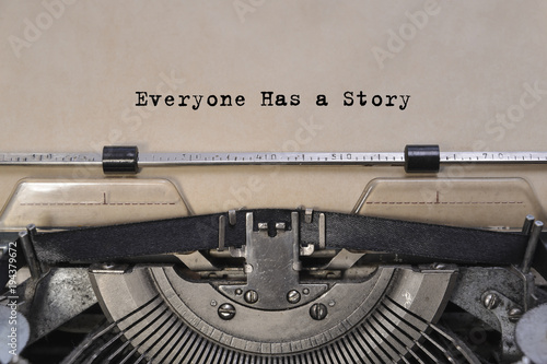 Everyone Has a Story text typed words on a old vintage typewriter. close up