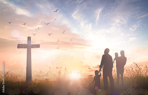 Fotografia, Obraz Family worship God concept: Silhouette people looking for the cross on autumn su