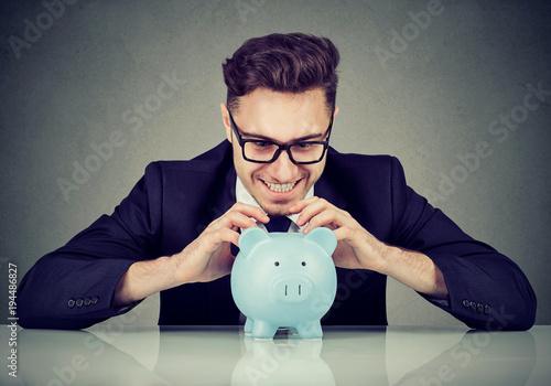 Obraz na płótnie Greedy businessman excited with money profit