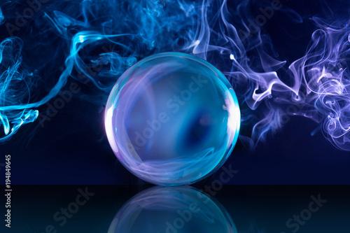 crystal ball in a dark blue smoky background