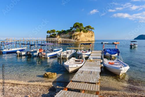 Платно Wooden bridge from Agios Sostis leading to small rocky island