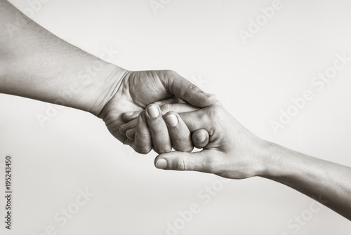 Fotografia Lending a helping hand. Solidarity, compassion, and charity.