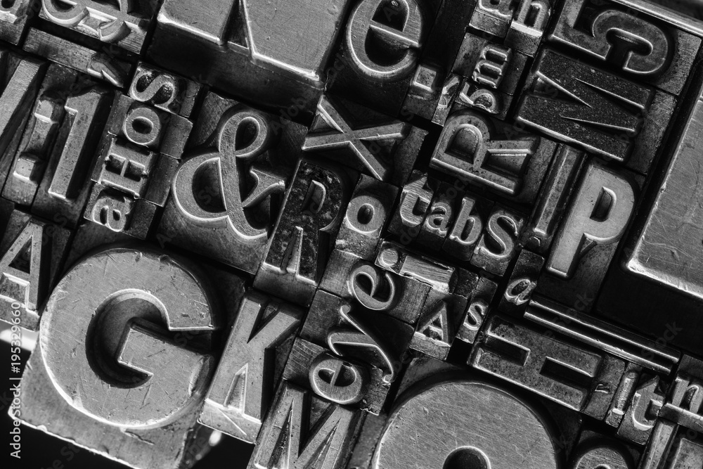 Metal Letterpress Types. A background from many historical typography letters in black and white with white background. <span>plik: #195329660 | autor: spr</span>