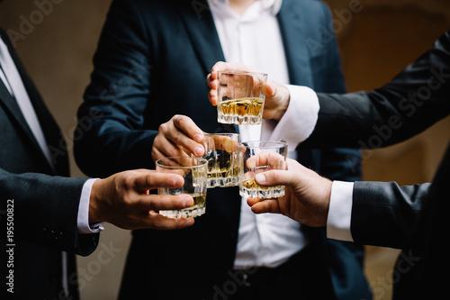 Valokuvatapetti Multiethnic group of businessmen spending time together drinking