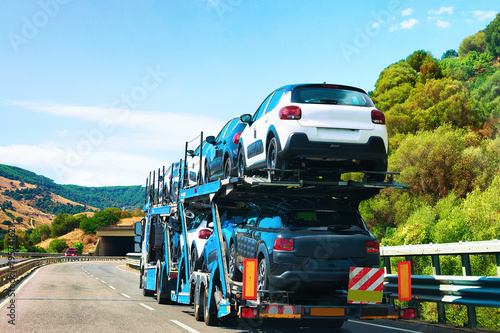Obraz na plátně Car transporter on road in Nuoro Sardinia