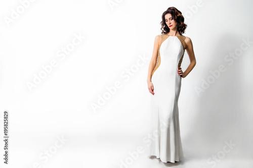 Obraz na plátne beautiful chic woman in white long dress
