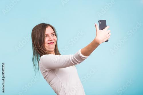 фотография April fools day concept - fool crazy woman make selfie