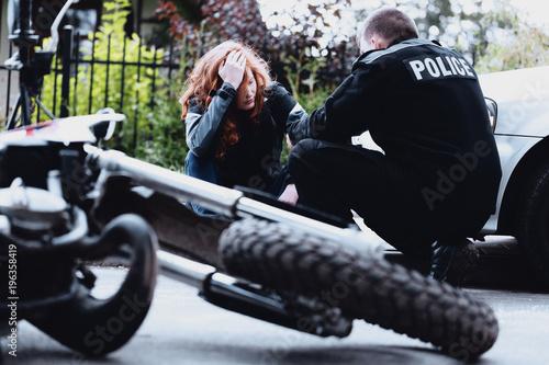 Policeman interviewing motorbike driver