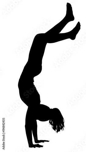 Tablou Canvas Sporty beautiful young woman working out indoors, doing handstand, vector silhouette illustration isolated on white background