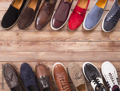 shoe collection on wood background