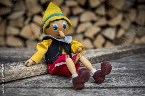 Old wooden pinocchio pupett marionette toy Fototapeta