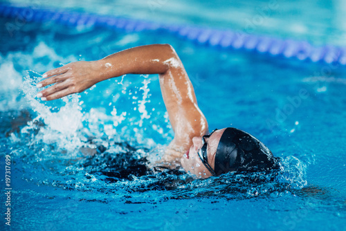 Canvas Print Professional swimmer, swimming race, indoor pool