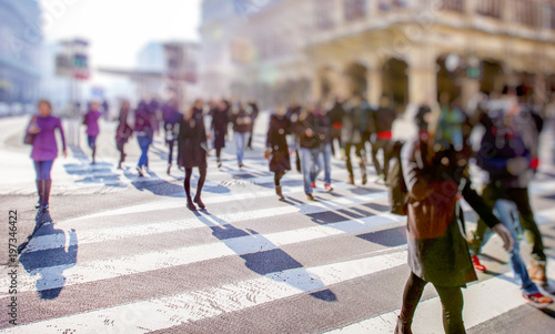 Fotografia Crowd of anonymous people walking on busy city street, urban life background