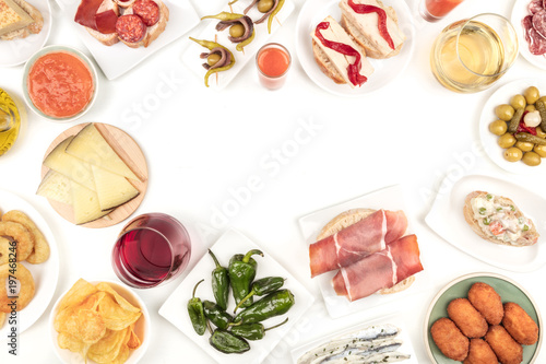 An overhead photo of Spanish tapas, forming frame on white with place for text
