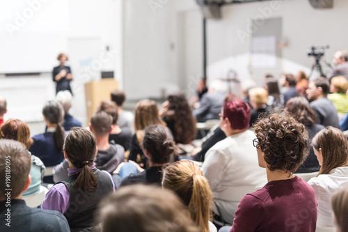 Female speaker giving presentation in lecture hall at university workshop Fototapeta