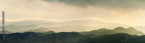 Fotografie, Tablou Amazing sunset sunrise and low clouds over the hills of Reserva Nacional La Chim