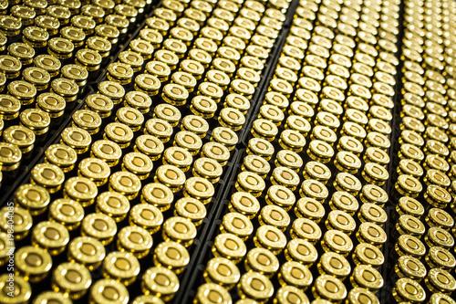 Hundreds of brass ammo rounds lined together Fototapeta