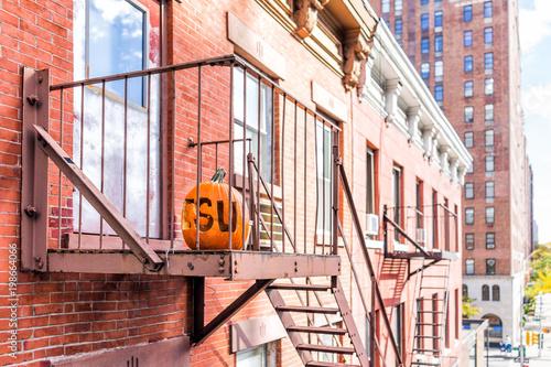 Photo Chelsea neighborhood brick fire escape apartment buildings, street below in New