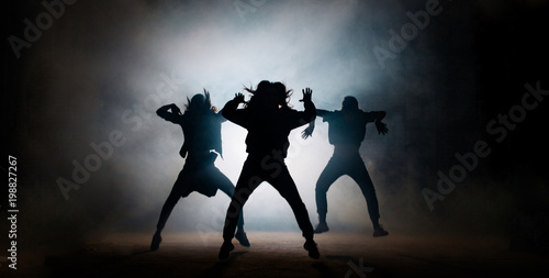 Canvas Print Group of young hip-hop dancers performing on the stage
