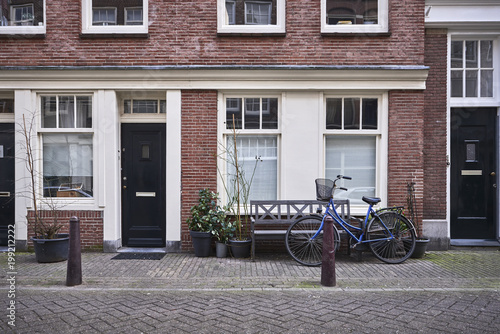 an old brick building with a bicycle