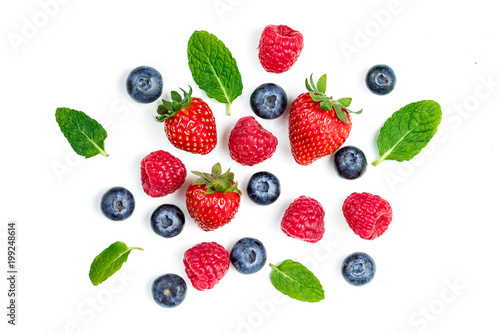 Fresh berries isolated on white background, top view. Strawberry, Raspberry, Blueberry and Mint leaf, flat lay.