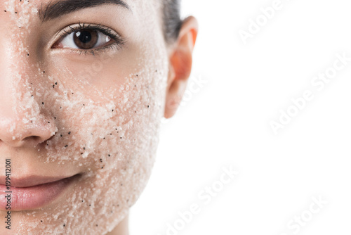 Fototapeta cropped image of beautiful girl with facial scrub looking at camera isolated on
