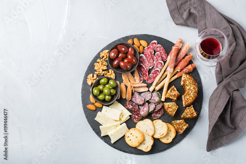 Assortment of spanish tapas or italian antipasti with wine