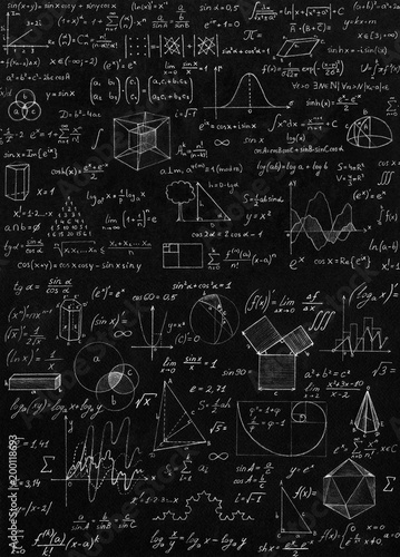 Blackboard inscribed with scientific formulas and calculations in physics and mathematics.