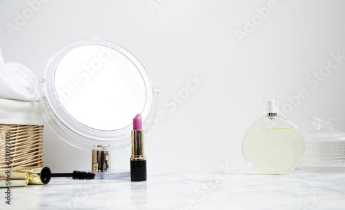 Valokuva women's accessories on table in the bathroom with a mirror and cosmetics