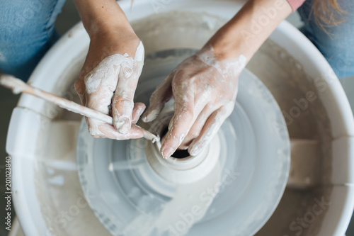 Leinwand Poster Handcrafted on a potter's wheel,Hands make clay from various items for home and