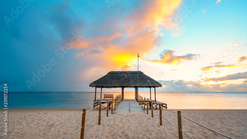 Canvas Print Amazing sunset in Mauritius Island (flic an flac beach) with Jetty silhouette