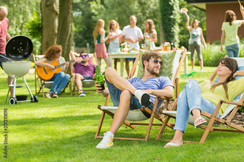 Young friends having barbecue picnic