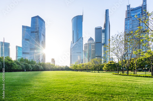 green lawn with modern building in park