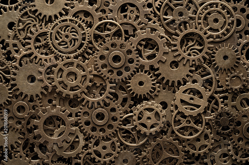 Fotografie, Obraz Brass cog wheels, steampunk background, texture with copy space