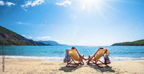 Happy couple relaxing on the beach