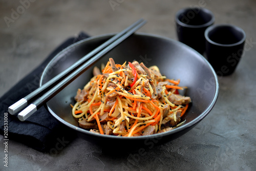 Asian vegetable salad with chicken giblets.