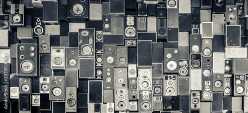 Panoramic view of speakers hanging on the wall in monochrome vintage style
