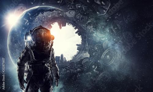 Photo Astronaut in fantasy world. Mixed media